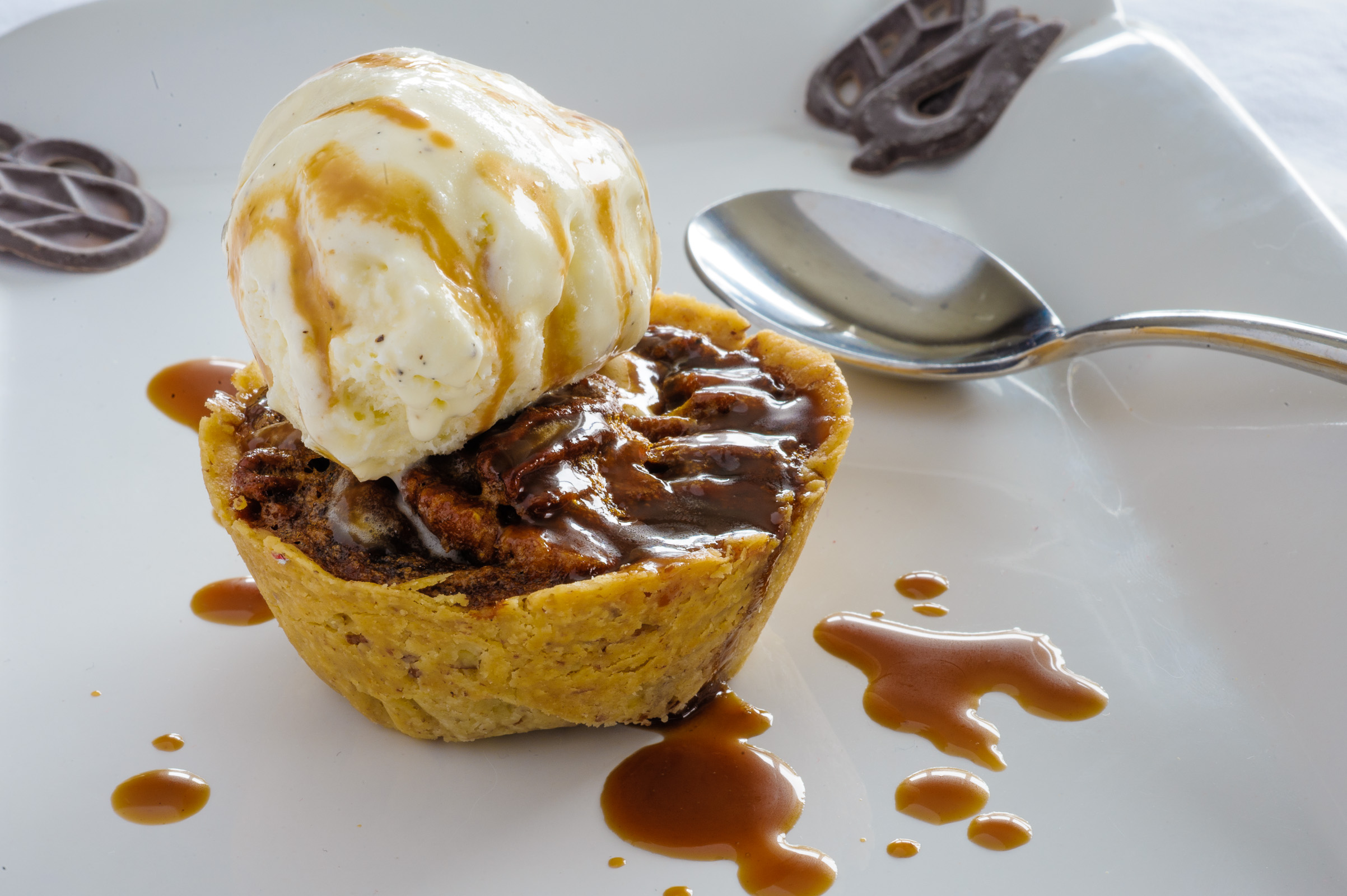 Pecan tart with caramel sauce and vanilla ice cream