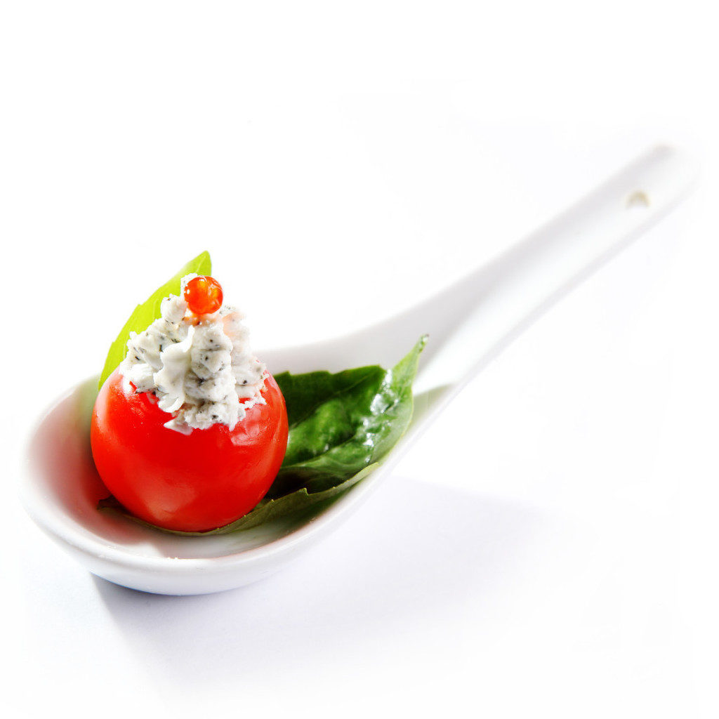Stuffed tomato on Asian spoon